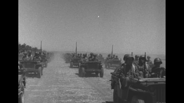 vídeos de stock, filmes e b-roll de king george vi reviews troops in tripoli during world war ii / king in a car stops to speak with a sikh soldier / gurkhas cheer king / large... - bernard l. montgomery