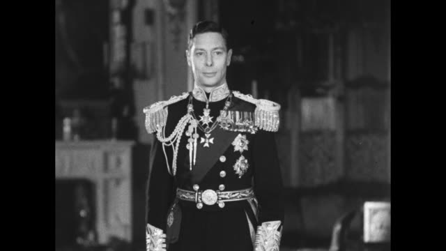 King George VI stands wearing his full dress Naval uniform but no helmet or hat / Note exact month/day not known