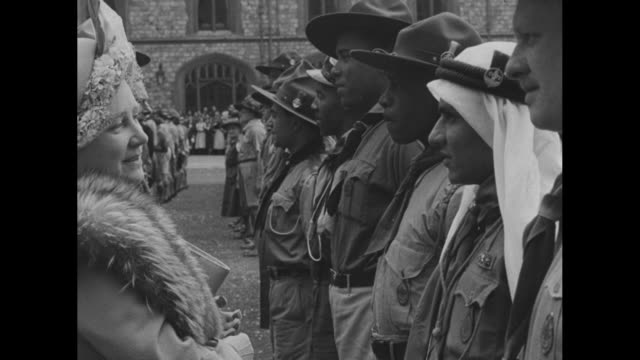 king george vi talks to scout leaders during a review of british commonwealth and international boy scouts who hold king's scout badges / queen... - princess margaret 1950 stock videos and b-roll footage