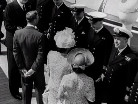 King George VI the Queen and Princess Margaret chat to various officers on the deck of the RMS Queen Elizabeth during their tour of the ship