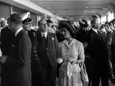 King George VI the Queen and Princess Margaret meet many of the crew onboard the RMS Queen Elizabeth during a tour of the ship