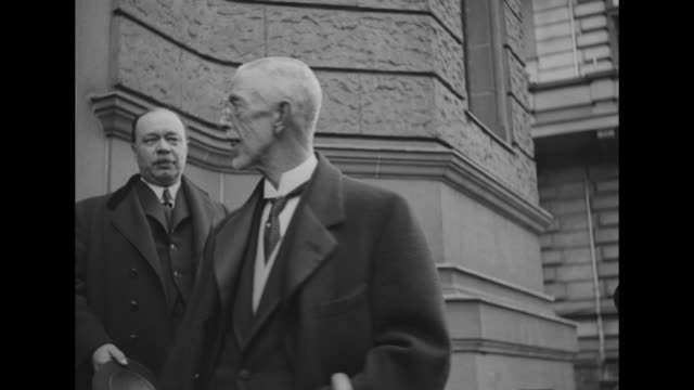 king gustaf v exiting building, officials behind him, he takes top hat off and puts it back on; he pauses for camera, cane hooked on arm, chauffeur... - top hat stock videos & royalty-free footage