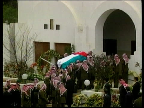 stockvideo's en b-roll-footage met king hussein of jordan funeral pool russian federation president boris yeltsin and wife naya down steps of aircraft pipe band along at funeral... - former