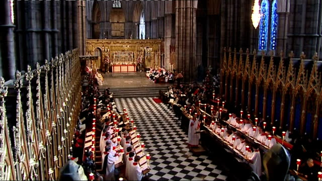 Westminster Abbey service High angle shot of choir and congregation singing hymn SOT