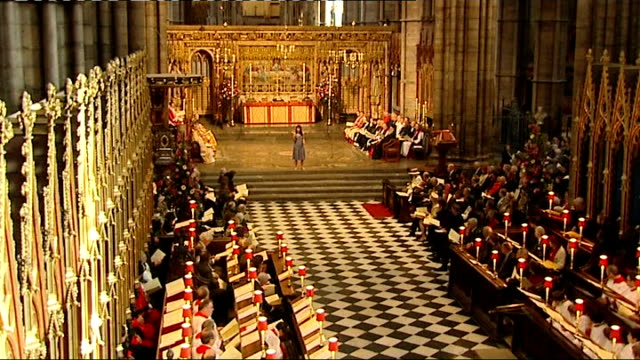 Westminster Abbey service Minister leads congregation in prayer/ woman performs reading to congregation/ CUTAWAYs high angle shots of Queen Elizabeth...