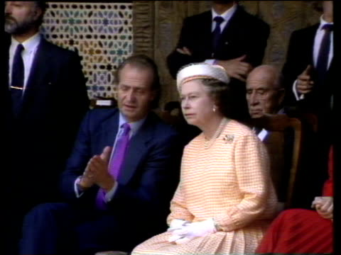 King Juan Carlos explains flamenco dancing to Queen Elizabeth II as he claps his hands together Seville 20 Oct 88