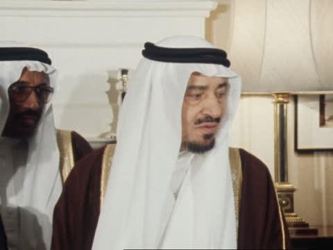 king khalid of saudi arabia state visit; england: london: westminster: downing street: ext king khalid of saudi arabia from car and greeted by mrs... - doorway stock videos & royalty-free footage