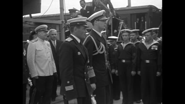 "king michael i gets off train, greets soviet official and romanian prime minister petru groza as he arrives at return of training ship ""mircea"" from... - romania stock videos & royalty-free footage"