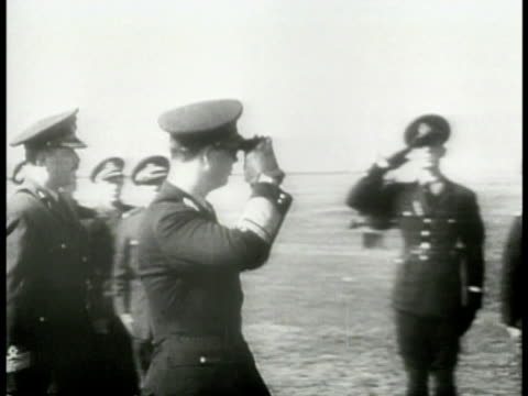 king michael i of the romanians saluting walking reviewing anti-aircraft battery soldiers. king michael i looking through gun sight. wwii world war... - romania stock videos & royalty-free footage