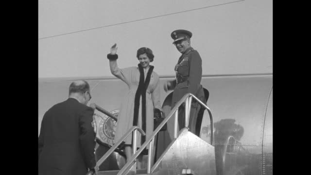 king paul queen frederica of greece stand on tarmac at new york's laguardia airport/ paul frederica walk to plane wave at well wishers / paul and... - state visit stock videos & royalty-free footage