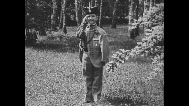 vs king peter ii dressed in military uniform salutes for camera / note exact day not known film has nitrate deterioration - nachfolger stock-videos und b-roll-filmmaterial
