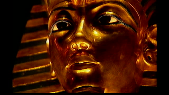 king tutankhamun's face revealed for the first time england london british museum **zahi hawass press conference overlaid sot** golden death mask of... - mask stock videos & royalty-free footage
