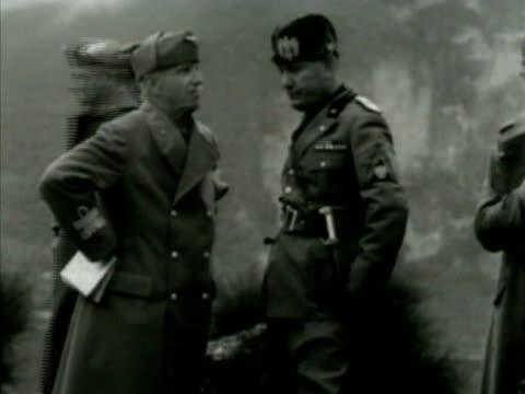 King Victor Emmanuel III of Italy talking w/ Fascist dictator Benito Mussolini Italian soldiers officers BG MS Emmanuel talking w/ Mussolini