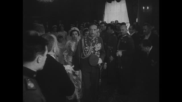 King Zog leading sister Senije's bridal procession wedding dinner Senije sitting w/ King Zog King Zog walking down steps w/ sister new husband under...