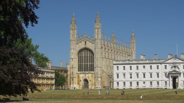 kings college chapel seen across the cam river - king's college cambridge stock videos and b-roll footage