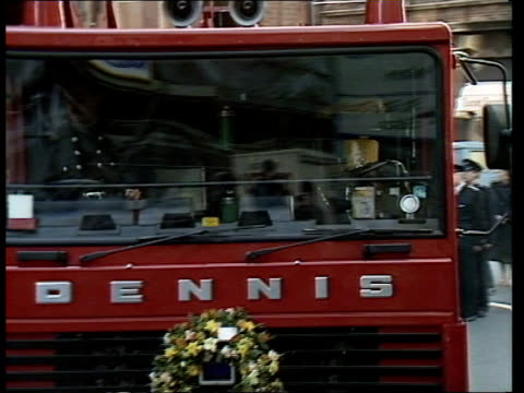 king's cross fire colin townsley funeral a central london ms red watch firemen lining pavement outside soho fire station pan rl l more cms fireman... - garden path stock videos and b-roll footage