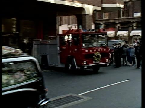 stockvideo's en b-roll-footage met colin townsley funeral; b) england: central london: red watch firemen lining pavement outside soho fire station r-lr-l morecms fireman r-l... - aan elkaar bevestigd