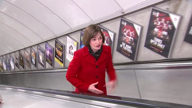 King's Cross fire Service held on 30th anniversary Reporter to camera on escalator