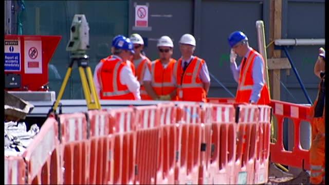 king's cross redevelopment: boris johnson lays stone at kings cross; england: london: kings cross: ext general views construction site area / workmen... - 尖塔点の映像素材/bロール
