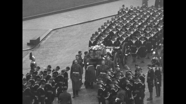 king's guard presents arms as caisson stands waiting for body of king george v to be brought out from palace of westminster where it has been lying... - kent england stock videos & royalty-free footage