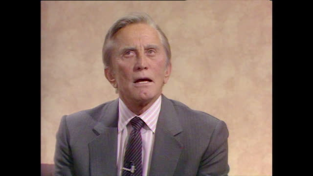 kirk douglas believes that actors and actresses are often quite shy and it is easier to hide behind a character - 1987 stock videos & royalty-free footage