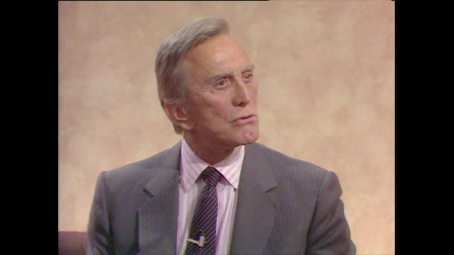 kirk douglas considers himself a failure in some respects because he didn't achieve his initial goal of becoming a broadway star - 1987 stock videos & royalty-free footage