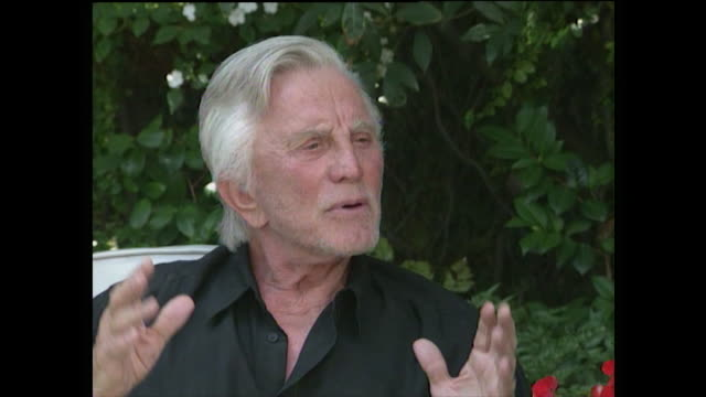 kirk douglas explains the purpose of the alzheimer's unit at the motion picture & television fund's country house and how he wished it to be named... - candid stock videos & royalty-free footage