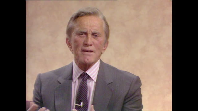 stockvideo's en b-roll-footage met kirk douglas finds that playing the villain or the 'bad guy' is far more interesting and has never tried to establish himself as a 'good guy' actor... - lichaamsverzorging