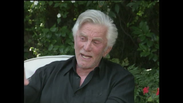 "kirk douglas responds to the question, ""when are you going to stop?"" and talks about the importance of having a focus in life and continuing to have... - altruism stock videos & royalty-free footage"