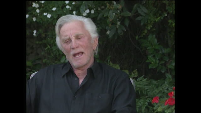 kirk douglas speaking in 1992 talks about modern films relying on special effects and violence and how he feels there will be a return to... - digital animation stock videos & royalty-free footage