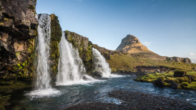 kirkjufell mountain and kirkjufellsfoss waterfall in iceland - falling water stock videos & royalty-free footage