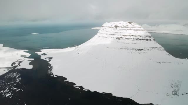 kirkjufell mountain at winter sunrise, iceland. aerial view - snäfellsnes stock-videos und b-roll-filmmaterial