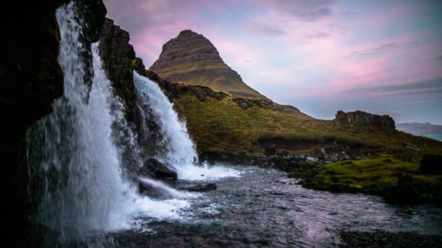 Kirkjufellsfoss and Kirkjufell mountain in Iceland - slow motion