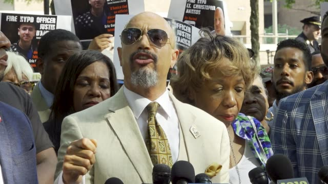 kirsten john foy minister of the gospel of jesus christ and founder arc of justice eric garner's mother gwen carr and activists rally at 1 police... - minister clergy stock videos and b-roll footage