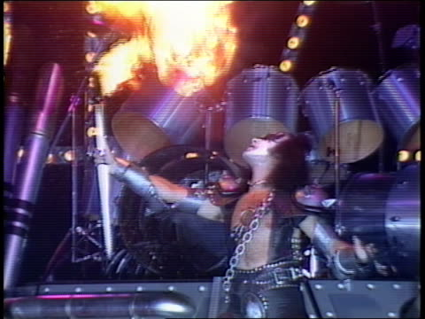 Kiss introducing to the press their new stage for the Creatures of the Night tour Gene Simmons in makeup 'breathing fire' with torch in front of the...