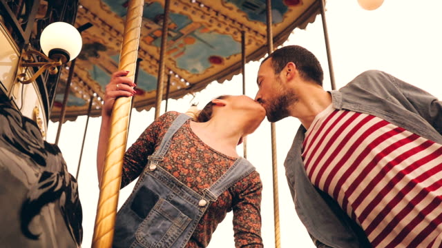 kiss on a carousel ride - kissing stock videos & royalty-free footage
