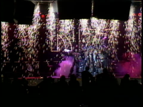 kiss on their new stage for the creatures of the night tour demonstrates effects for the press shower of sparks followed by posing for photos in the... - heavy metal stock videos & royalty-free footage
