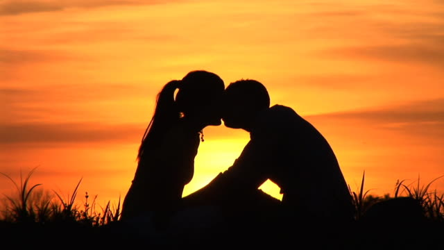hd: kissing at sunset - silhouette stock videos & royalty-free footage