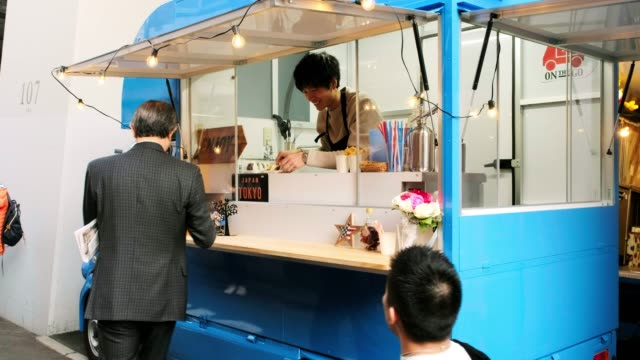 kitchen car food truck in tokyo japan - food and drink establishment stock videos & royalty-free footage