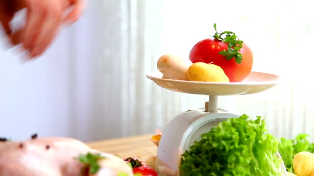 kitchen scales and fresh vegetables - weight scale stock videos & royalty-free footage
