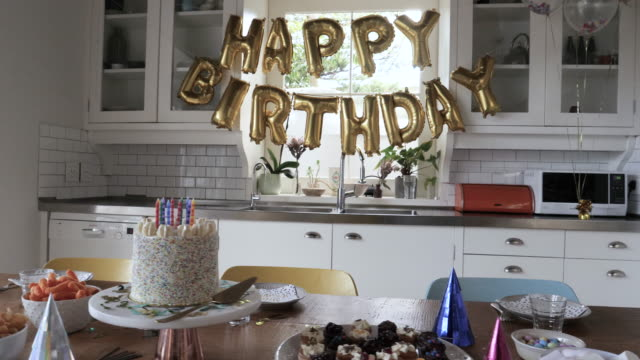 kitchen set up for birthday party, medium shot - capital letter stock videos & royalty-free footage