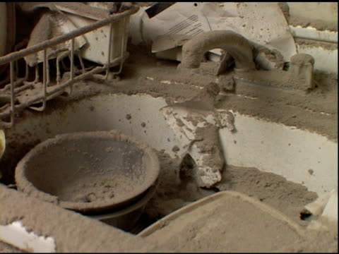 VS kitchen sink and dish rack covered with dust dirt in Liberty St apartment near Ground Zero after September 11 2001 terrorist attacks tea kettle...