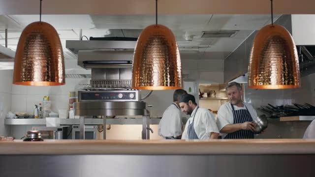 kitchen staff working in restaurant - uniform stock videos & royalty-free footage