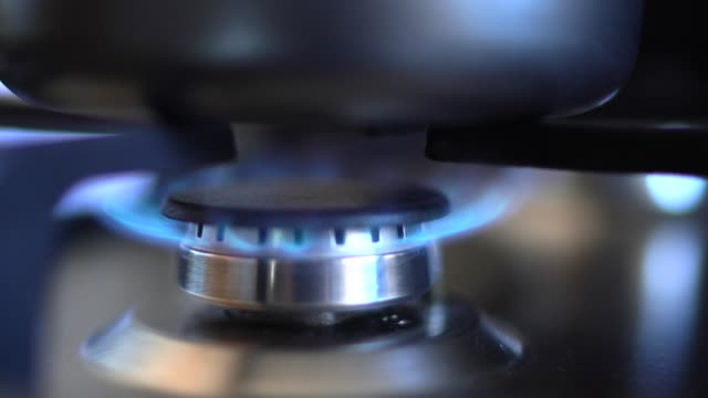 kitchen stove with blue flames burning (turning on) - gas stock videos & royalty-free footage