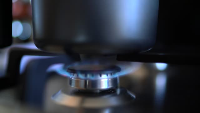 kitchen stove with blue flames burning (turning on) - hob stock videos & royalty-free footage
