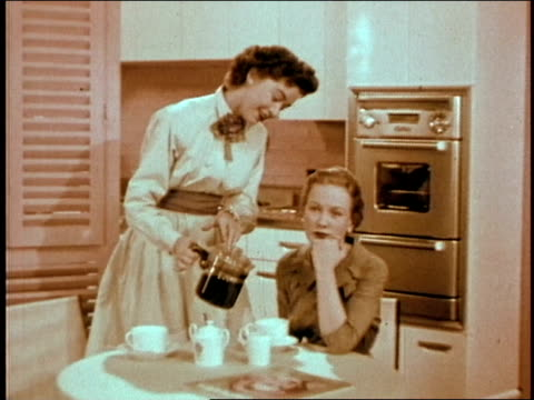 kitchen, two women having coffee. - 10 seconds or greater stock videos & royalty-free footage