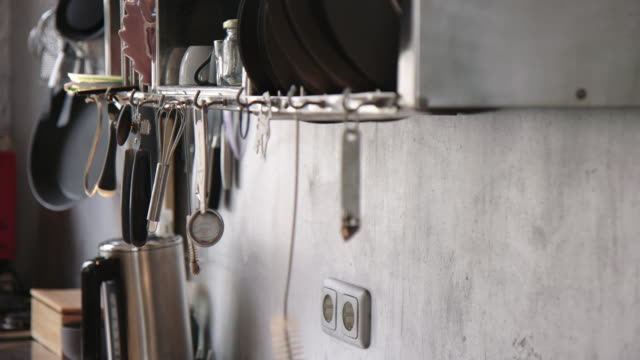 kitchen utensils hanging on pantry rack in office - utensil stock videos & royalty-free footage