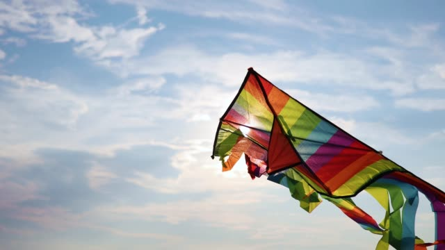 kite flying in the sky - rainbow stock videos & royalty-free footage
