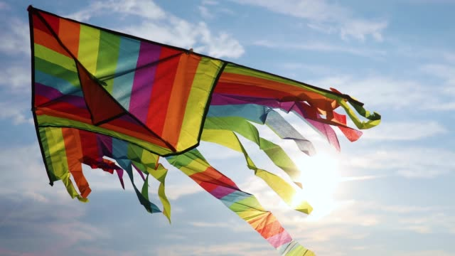 kite flying in the sky - kite toy stock videos and b-roll footage