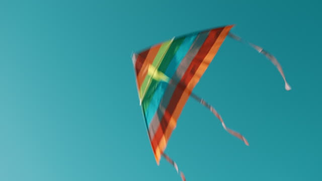 kite flying in the sky - multi coloured stock videos & royalty-free footage